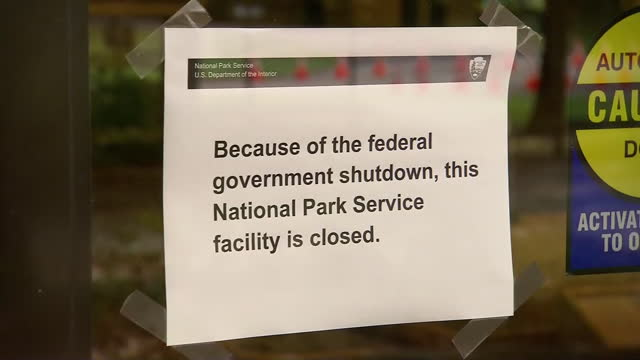 stockvideo's en b-roll-footage met a road and a road sign near gatlinburg tennessee are seen during the 2013 government shutdown - united states and (politics or government)
