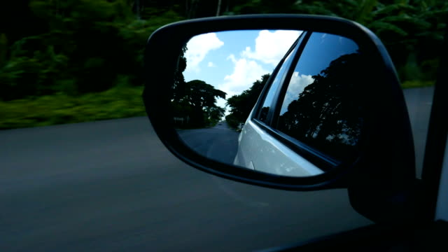 road and blue sky on side car mirror - overtaking stock videos and b-roll footage