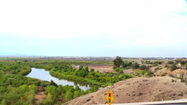 ws pan road and bridges crossing colorado river, interstate 8 in background, yuma, arizona, usa - arizona stock videos & royalty-free footage