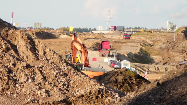 road and cars on construction site - road construction stock videos and b-roll footage