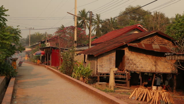ws road and houses in village / luang prabang, laos - laos stock videos and b-roll footage