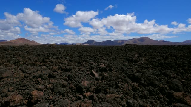 road and lava landscape near los hervideros, lanzarote, canary islands, spain, atlantic, europe - atlantic islands stock videos & royalty-free footage