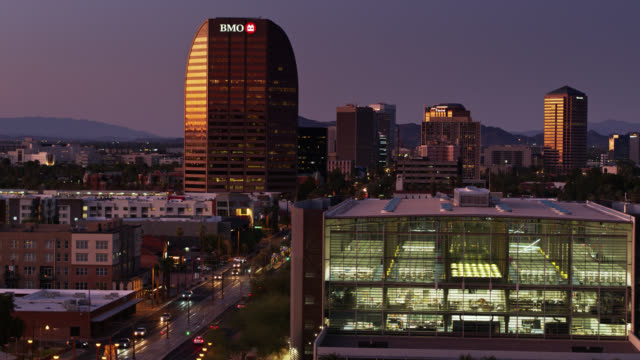 road and light rail tracks in downtown phoenix, az at twilight - aerial view - arizona stock videos & royalty-free footage