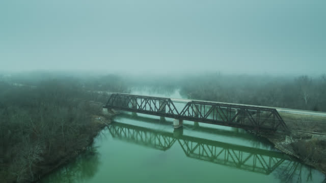 road and railway bridges over illinois river in fog - aerial - tramway stock videos & royalty-free footage