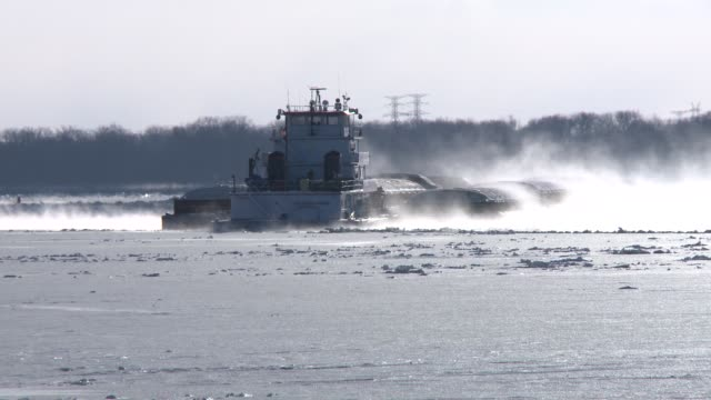 Road and river travel hampered by Winter Storm Ion Blowing snow coats road and snow and ice coat riverboats Arctic weather lashes US midwest with...