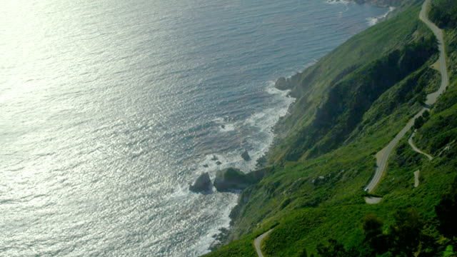 A road at California's Big Sur leads along the cliffs over the Pacific coast.
