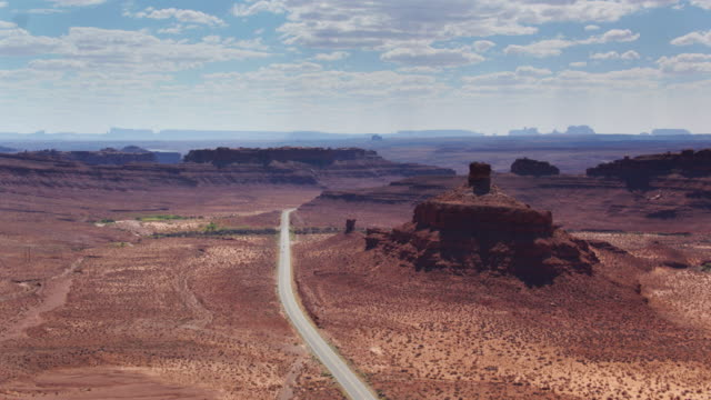 road between buttes and ridges in monument valley - navajo reservation stock videos and b-roll footage