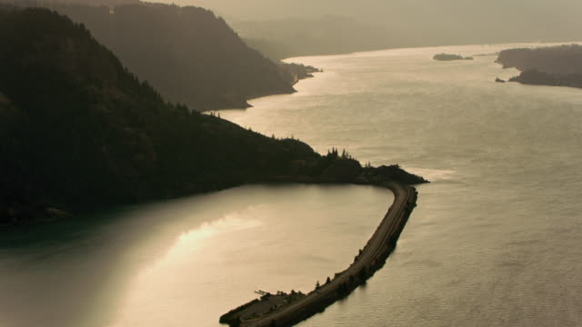 AERIAL Road between the Columbia River and a lake at sunrise