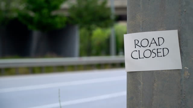 road closed sign - road closed sign stock videos & royalty-free footage