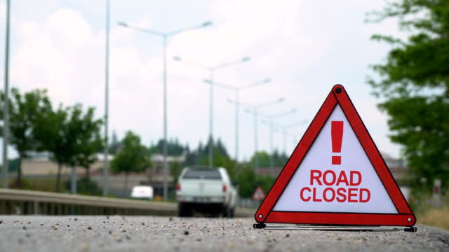 road closed! - traffic sign - warning sign stock videos & royalty-free footage