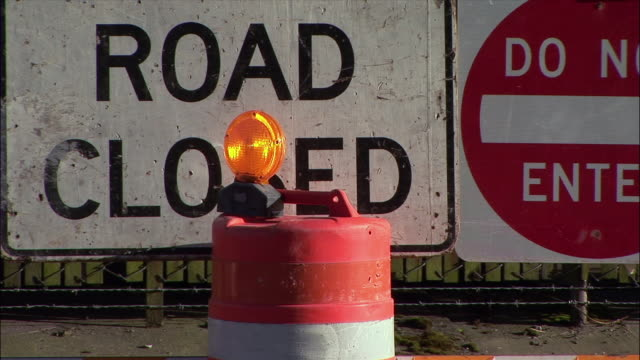 zo, 'road closed' warning signs behind traffic barrel - road marking stock videos & royalty-free footage