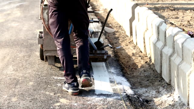 road construction (installing rumble strips) - road construction stock videos and b-roll footage