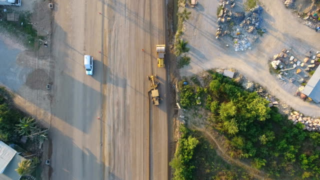road construction with beautiful sunlight, aerial top view - digging stock videos and b-roll footage