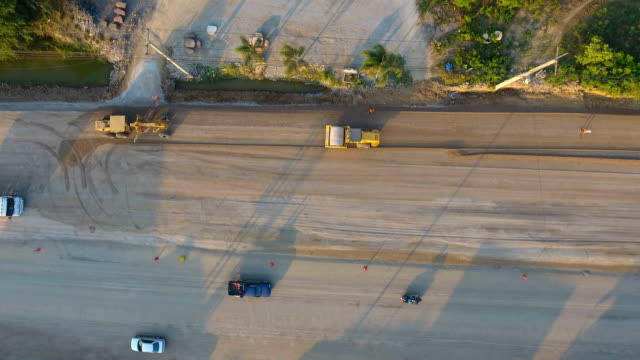 road construction with beautiful sunlight, aerial top view - road construction stock videos and b-roll footage
