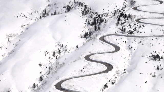 road crews relying on gps satellite data to dig out the snowy tateyama kurobe alpine route that cuts through the tateyama mountain range in the... - toyama prefecture stock videos and b-roll footage
