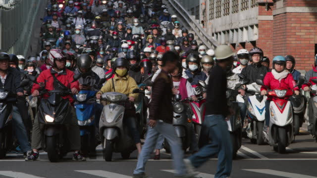 ls a road crowded with motorcycles during rush hour / taipei, taiwan - population explosion stock videos & royalty-free footage