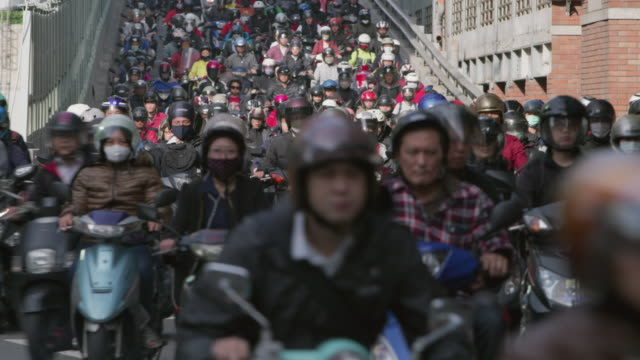 ls a road crowded with motorcycles during rush hour / taipei, taiwan - taiwan video stock e b–roll