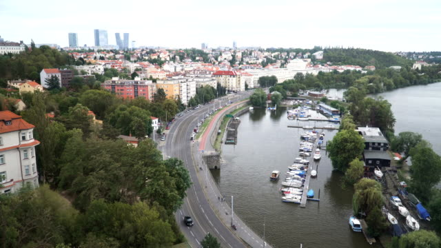 road curve near yacht boat port on Vitava river, Prague