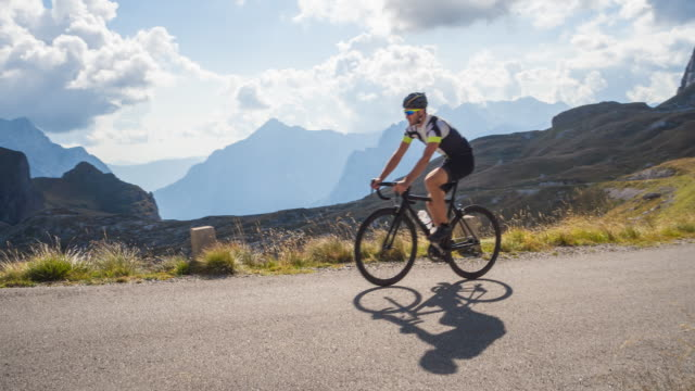 road cycling in mountains on beautiful sunny day - cycling helmet stock videos & royalty-free footage