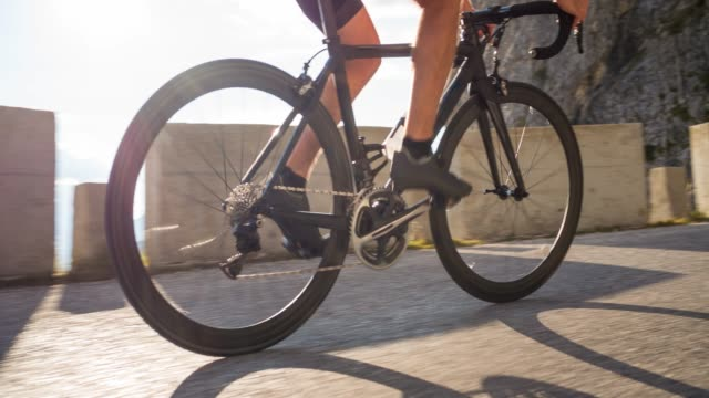 road cycling in mountains - outdoor pursuit stock videos & royalty-free footage