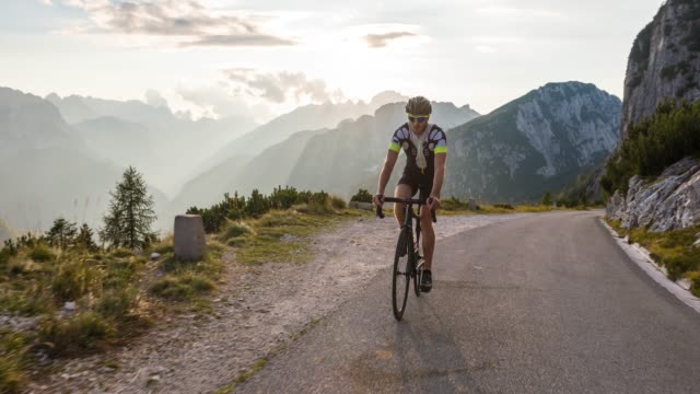 road cycling in mountains - overcast stock videos & royalty-free footage