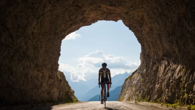 road cycling into a rocky tunnel - tunnel stock videos & royalty-free footage