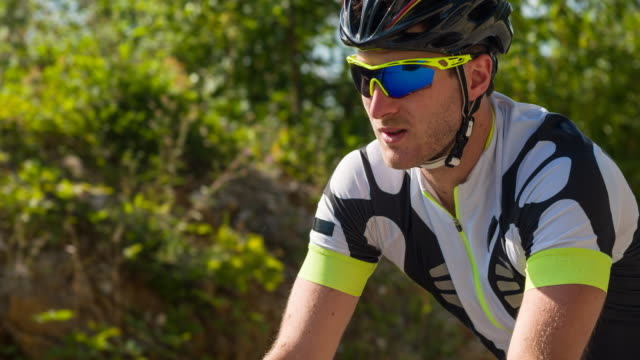 road cycling on a hot sunny day - cycling event stock videos & royalty-free footage