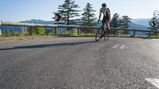 road cycling on a mountain pass - triathlon stock videos & royalty-free footage