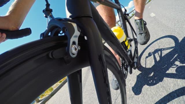 road cyclist cycling downhill - triathlon stock videos & royalty-free footage