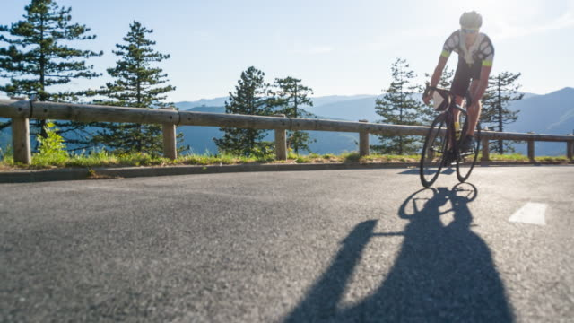 road cyclist in lead of the competition - lead stock videos and b-roll footage