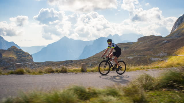 road cyclist on a mountain pass - panoramic stock videos & royalty-free footage