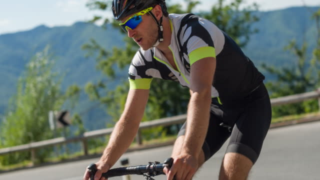Road cyclist on a winding road