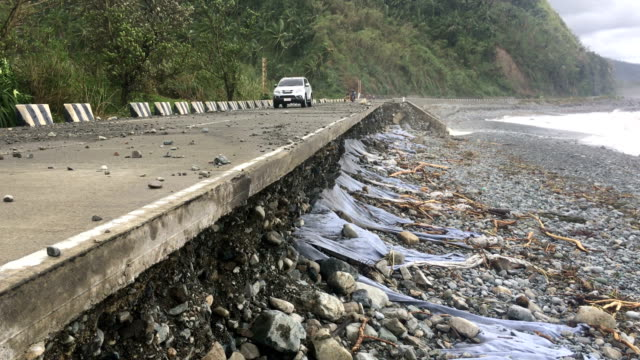Road damaged by waves from typhoon Sarika in the Philippines
