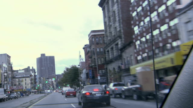 road downtown and buildings - parallel parking stock videos & royalty-free footage