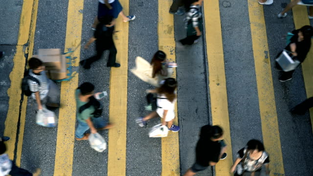 road in central hongkong, pedestrian crossing - incidental people stock videos & royalty-free footage