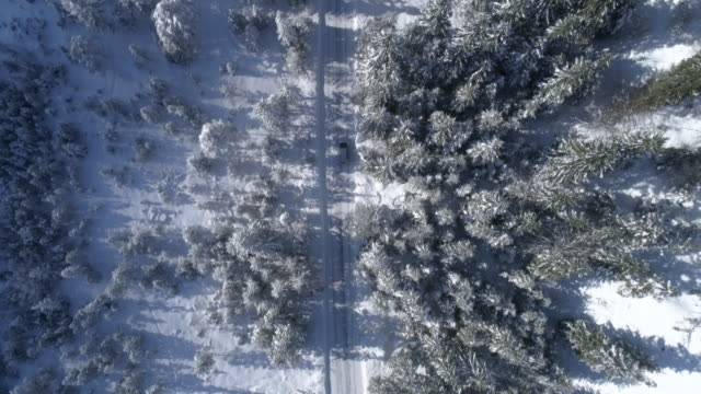 road in snowy winter landscape and mountains - draufsicht stock-videos und b-roll-filmmaterial