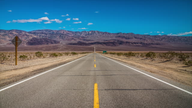 road in the desert - death valley national park stock videos & royalty-free footage