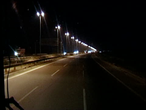 road into baghdad at night iraq - baghdad stock videos & royalty-free footage