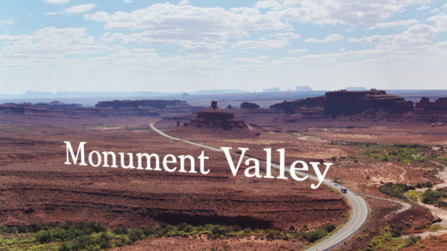 road into monument valley with floating text - navajo reservation stock videos and b-roll footage