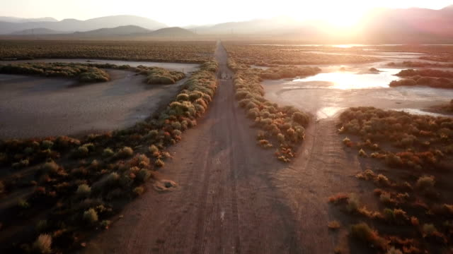 Road Into Wide Plain in California at Sunrise