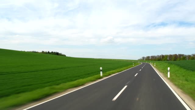 Road leading through countryside in spring, Birkenfeld, Marktheidenfeld, Franconia, Bavaria, Germany