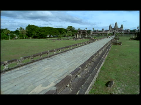 ws, td, road leading to angkor wat temple, angkor, cambodia - letterbox format stock videos & royalty-free footage