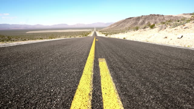 ds road lines on an empty road through a desert - tarmac stock videos & royalty-free footage