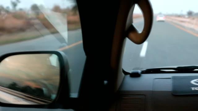 road marking lines view from the inside of a running vehicle on motorway or highway - förarperspektiv bildbanksvideor och videomaterial från bakom kulisserna