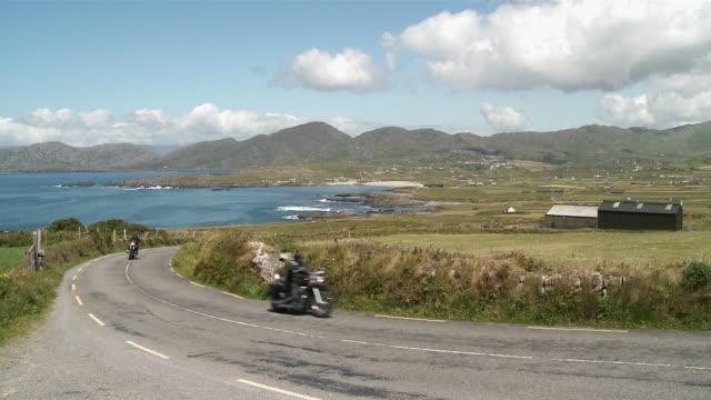 ws road near by ocean / allihies,  county cork, ireland - county cork stock videos & royalty-free footage
