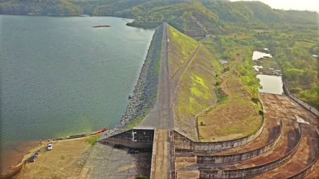 AERIAL: Road on a dam in sunshine