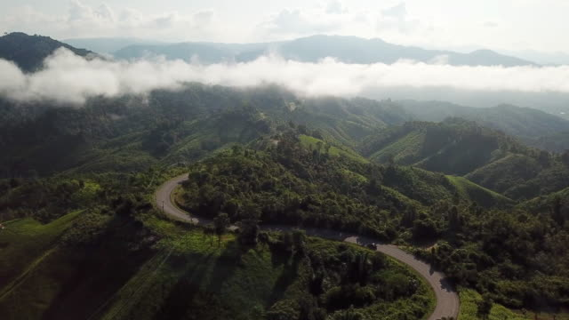 road on the mountain and car driving on the road with mountain and green forest , aerial shot - southeast asia stock videos & royalty-free footage