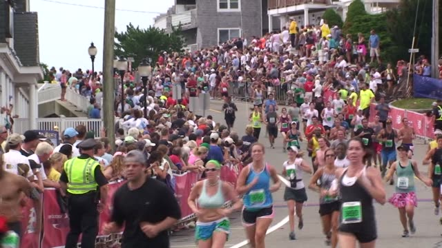 road racing the great american road race an annual event on cape cod along martha's vineyard sound runners down final hill to finish line - salmini stock videos and b-roll footage