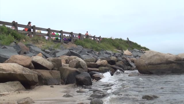 stockvideo's en b-roll-footage met road racing the great american road race an annual event on cape cod along martha's vineyard sound runners beach and waves - salmini