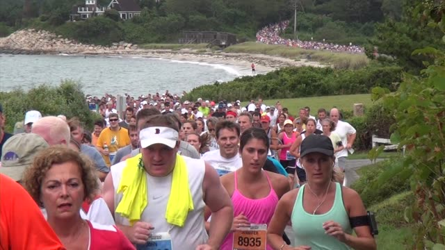 road racing the great american road race an annual event on cape cod along martha's vineyard sound runners stream out along beach - salmini stock videos & royalty-free footage